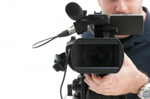 bigstock-Video-camera-operator-working--29807411